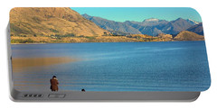 Shooting Ducks On Lake Wanaka Portable Battery Charger by Stuart Litoff