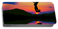 Silhouette Of Happy Woman Jumping At Sunset Portable Battery Charger