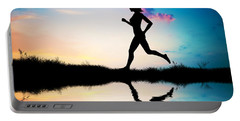 Silhouette Of Woman Running At Sunset Portable Battery Charger