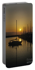 Silhouetted Man On Sailboat Portable Battery Charger