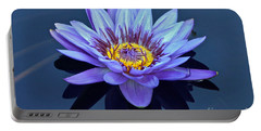 Single Lavender Water Lily Portable Battery Charger by Byron Varvarigos