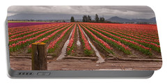 Portable Battery Charger featuring the photograph Skagit Valley Tulip Farmlands In Spring Storm Art Prints by Valerie Garner