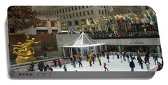 Skating In Rockefeller Center Portable Battery Charger by Judith Morris