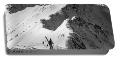 Skier Hikes Along A Ridge Portable Battery Charger