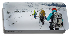 Skiers Descend A Ridge After Climbing Portable Battery Charger
