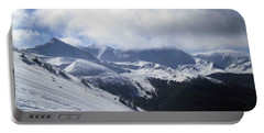 Portable Battery Charger featuring the photograph Skiing With A View by Fiona Kennard
