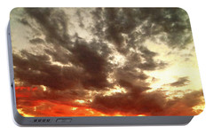 Portable Battery Charger featuring the photograph Sky Moods - Stoking The Coals by Glenn McCarthy