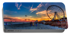 Skywheel Sunset At Myrtle Beach Portable Battery Charger by Robert Loe
