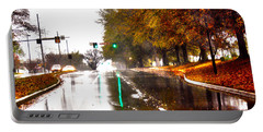 Portable Battery Charger featuring the photograph Slick Streets Rainy View by Lesa Fine