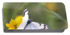 Small White Butterfly On Yellow Flower Portable Battery Charger by Belinda Greb