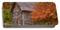 Portable Battery Charger featuring the photograph Small Wooden Shack In The Autumn Colors by Jeff Folger