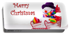 Portable Battery Charger featuring the photograph Snowman Riding In A Red Sleigh - Christmas  by Vizual Studio