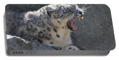 Portable Battery Charger featuring the photograph Snow Leopard Yawn by Neal Eslinger