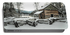 Portable Battery Charger featuring the photograph Snowy Log Cabin by Debbie Green