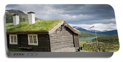 Portable Battery Charger featuring the photograph Sod Roof Log Cabin by IPics Photography