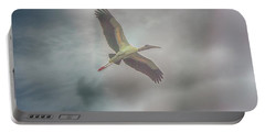 Portable Battery Charger featuring the photograph Solo Flight by Dennis Baswell