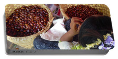 Portable Battery Charger featuring the photograph Sorting Water Chestnuts Zay Cho Street Market 29th Street Mandalay Burma by Ralph A  Ledergerber-Photography