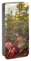 Spider Web Portable Battery Charger by Edward Fielding