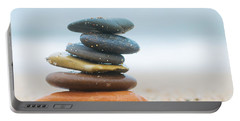 Stack Of Beach Stones On Sand Portable Battery Charger