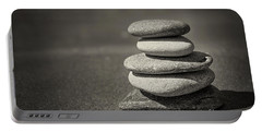 Stacked Pebbles On Beach Portable Battery Charger