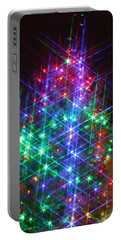Portable Battery Charger featuring the photograph Star Like Christmas Lights by Patrice Zinck
