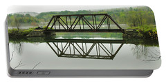 Portable Battery Charger featuring the photograph Vermont Steel Railroad Trestle On A Calm  Misty Morning by Sherman Perry