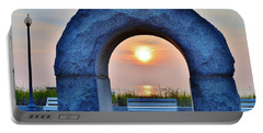 Portable Battery Charger featuring the photograph Sunrise Through The Arch - Rehoboth Beach Delaware by Kim Bemis