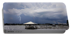 Portable Battery Charger featuring the photograph Storm Over Clay Lake by Rosalie Scanlon