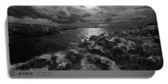 Blank And White Stormy Mediterranean Sunrise In Contrast With Black Rocks And Cliffs In Menorca  Portable Battery Charger by Pedro Cardona