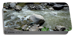 Portable Battery Charger featuring the photograph Stream Water Foams And Rushes Past Boulders by Imran Ahmed