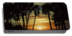 Portable Battery Charger featuring the photograph Sultry Sunset by Janie Johnson