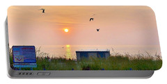 Portable Battery Charger featuring the photograph Sunrise At Rehoboth Beach Boardwalk by Kim Bemis
