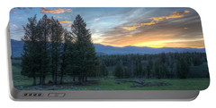 Sunrise Behind Pine Trees In Yellowstone Portable Battery Charger