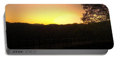 Portable Battery Charger featuring the photograph Sunset Behind Hills by Jonny D