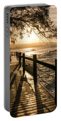 Sunset Over Ocean Walkway Portable Battery Charger