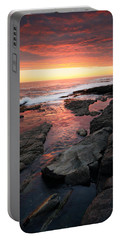 Sunset Over Rocky Coastline Portable Battery Charger