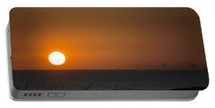Sunset Over The Windfarm Portable Battery Charger by Spikey Mouse Photography