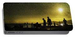 Portable Battery Charger featuring the photograph Sunset Silhouette Of People At The Beach by Peter v Quenter