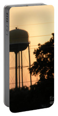 Portable Battery Charger featuring the photograph Sunset Water Tower by Joseph Baril
