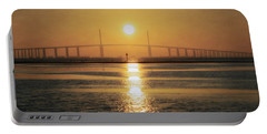 Portable Battery Charger featuring the photograph Sunshine Skyway Bridge Sunrise by Steven Sparks