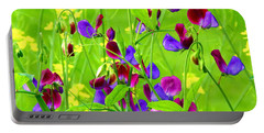 Portable Battery Charger featuring the photograph Sweet Peas by Byron Varvarigos