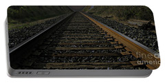 Portable Battery Charger featuring the photograph T Rails by Janice Westerberg