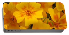 Portable Battery Charger featuring the photograph Tagette Marigold Blossoms Macro by Sandra Foster