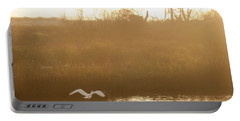 Portable Battery Charger featuring the photograph Taking Off Into A Golden Sunrise by Carol Lynn Coronios