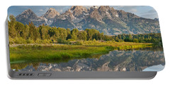 Portable Battery Charger featuring the photograph Teton Range Reflected In The Snake River by Jeff Goulden