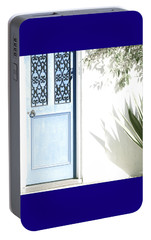 Portable Battery Charger featuring the photograph The Blue Door by Holly Kempe