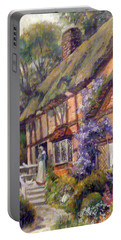 Portable Battery Charger featuring the painting The Cottage by Donna Tucker