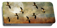The Flight Of The Snow Geese Portable Battery Charger by Lois Bryan