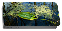 Portable Battery Charger featuring the photograph The Floating Leaf Of A Water Lily by Verana Stark