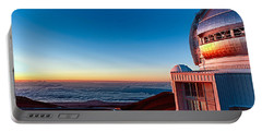 Portable Battery Charger featuring the photograph The Glow Of The Warm Sunset Reflecting Off Of The Gemini 8.1m Op by Jim Thompson
